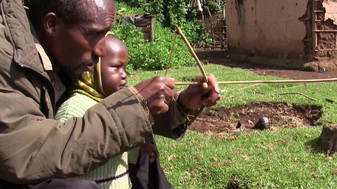 Ogiek-Still-Beutan-teaching-son-to-hunt